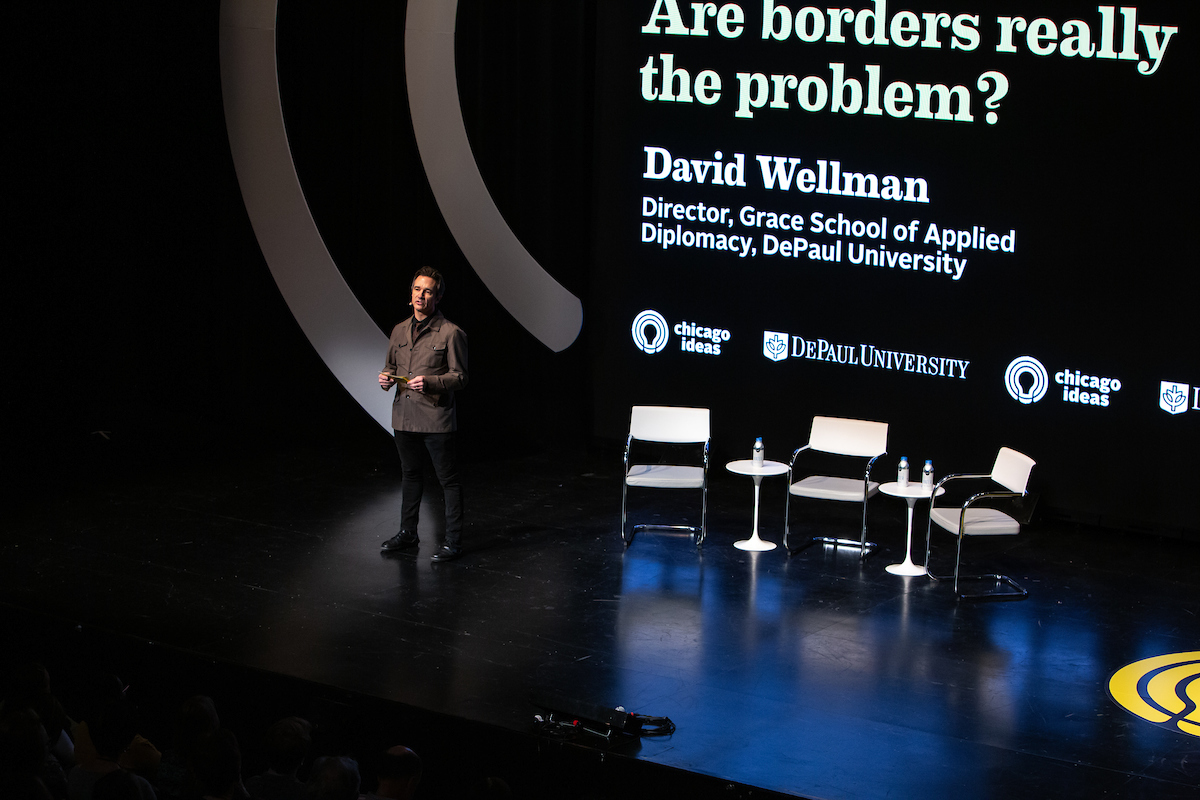 David Wellman, associate professor of Religious Studies, Peace, Justice and Conflict Studies and director of DePaul's School of Applied Diplomacy, introduces panelists during the Chicago Ideas Week