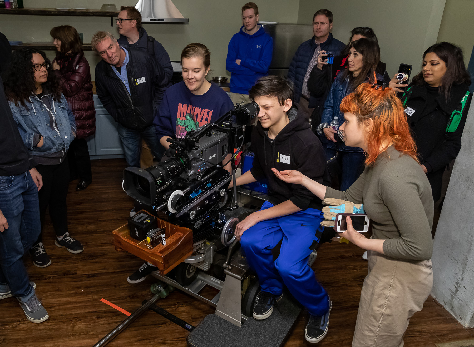 Attendees try out film equipment during the Chicago Ideas Week Lab: Behind the Scenes at Cinespace with DePaul University, Monday, Oct. 14, 2019, at Cinespace Chicago Film Studios on Chicago's West Side. (DePaul University/Jeff Carrion)