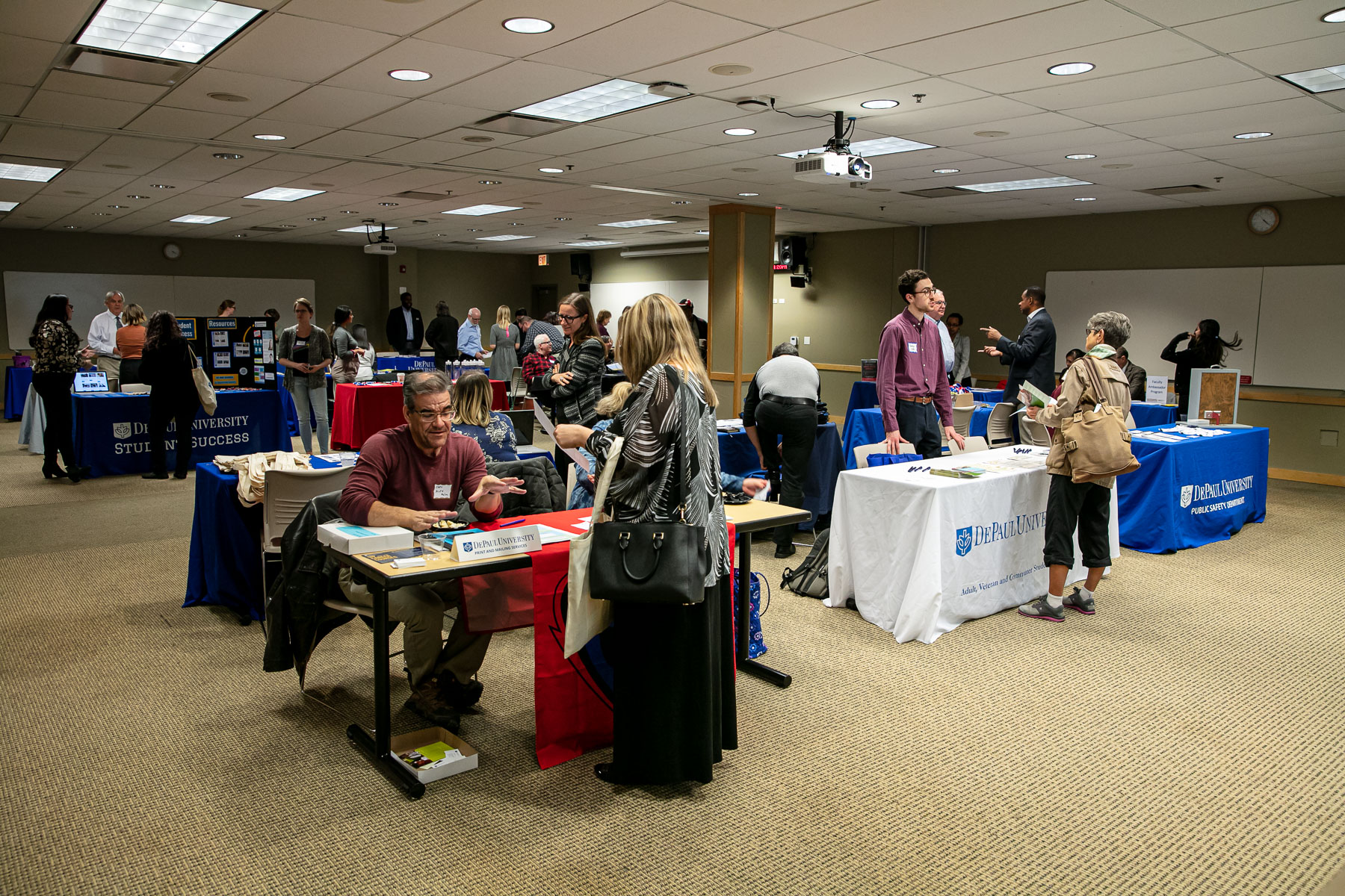More than 20 departments set up educational booths in the Student Center, and attendees were able to engage with department representatives about campus resources for adjunct faculty. (DePaul University/Randall Spriggs)