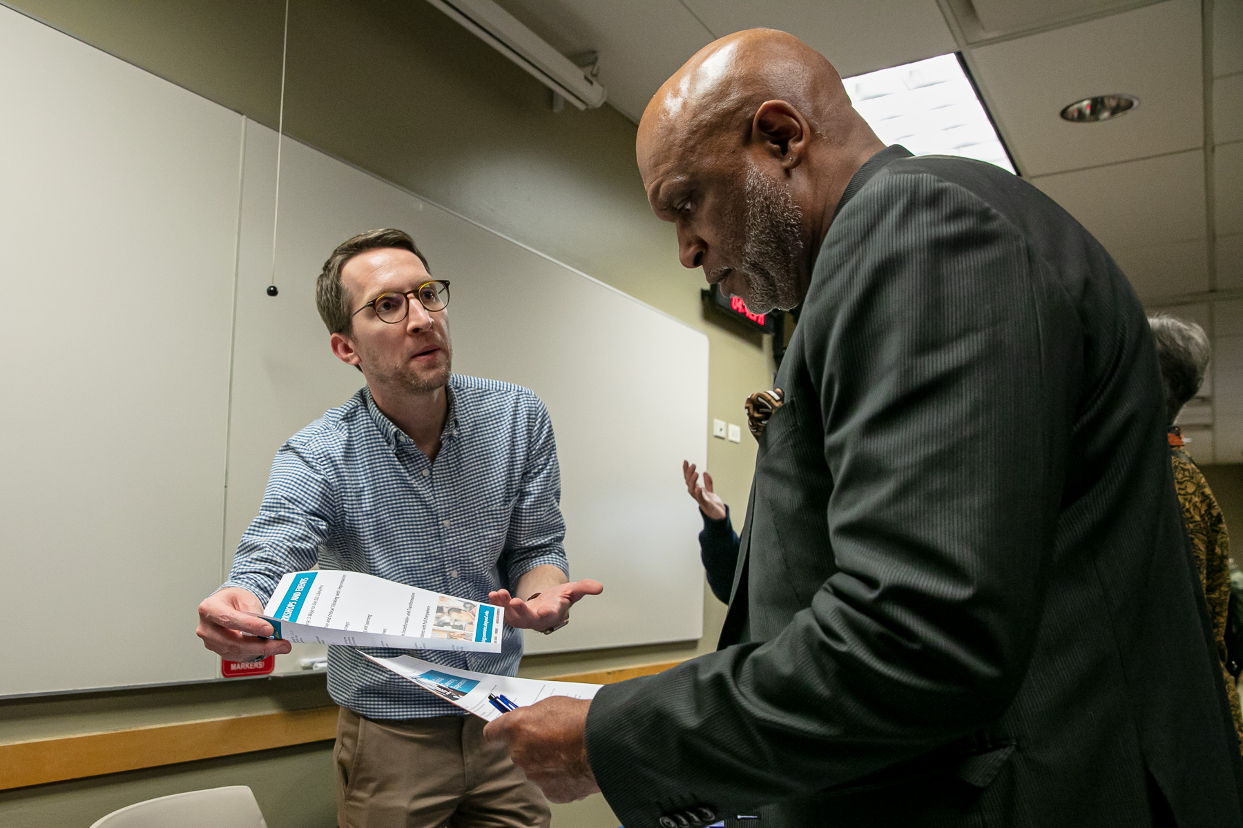 Daniel Stanford, director of faculty development in the Center for Teaching and Learning, presents information regarding teaching development seminars to adjunct faculty. (DePaul University/Randall Spriggs)