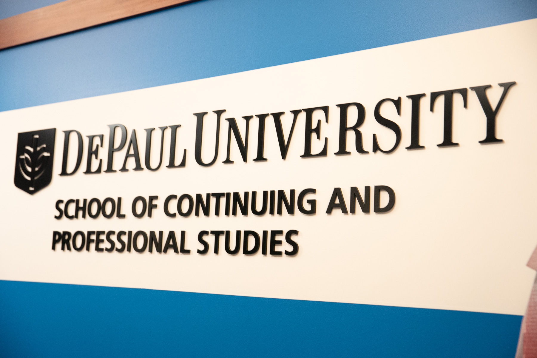 A new sign displaying SCPS's new moniker graces the Daley building's 14th floor lobby. (DePaul University/Randall Spriggs)