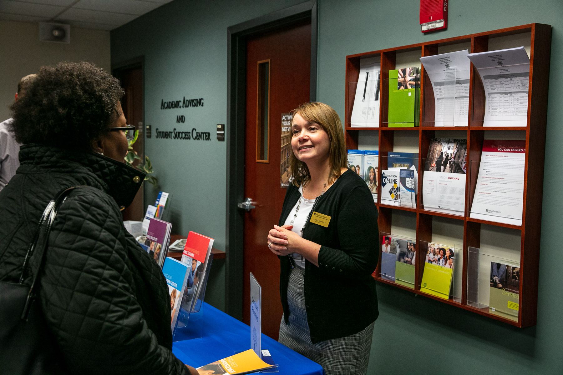 Sandy Rodriguez, marketing communications specialist, shares information about resources available at the School of Continuing and Professional Studies. (DePaul University/Randall Spriggs)
