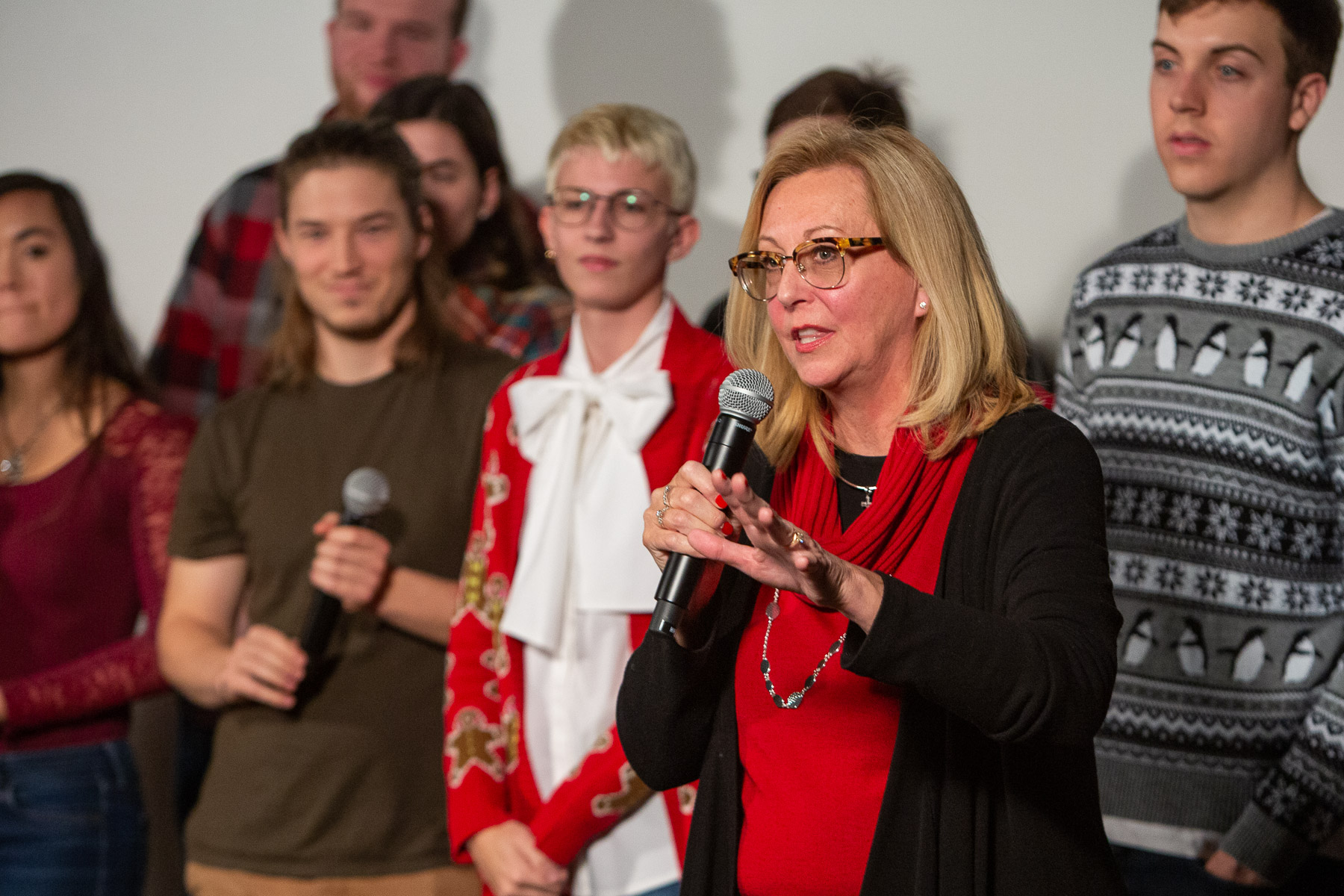 "JoAnne Zielinski, associate dean in the College of Computing and Digital Media, gives remarks during the premiere of the stop-motion film ""Merry Christmas from DePaul."" The film is the center of a holiday window display on State Street on DePaul's Loop Campus. (DePaul University/Randall Spriggs)"