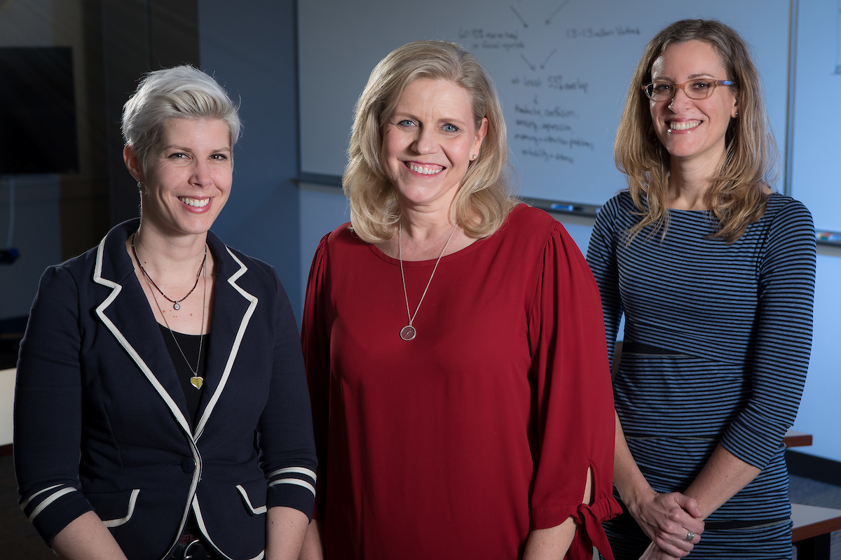 From left to right: Faculty Doris Rusch, Dorothy Kozlowski and Sonya Crabtree-Nelson earned an Academic Initiatives Program grant to raise awareness in Chicago about the intersection of domestic violence and traumatic brain injury. (DePaul University/Jeff Carrion)