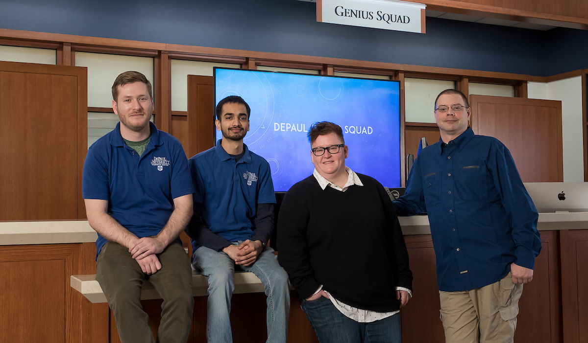 Left to right: Justin Smith and Neel Patel, Genius Squad student technicians; Marlyece Blum, Genius Squad team lead in the Lincoln Park Campus; and Robert Kamka, Genius Squad team lead in the Loop Campus. DePaul's Genius Squad provides technical service and support for desktops, laptops, phones, tablets and other personal electronic devices to all faculty, staff and students.​​​​ (DePaul University/Jeff Carrion)