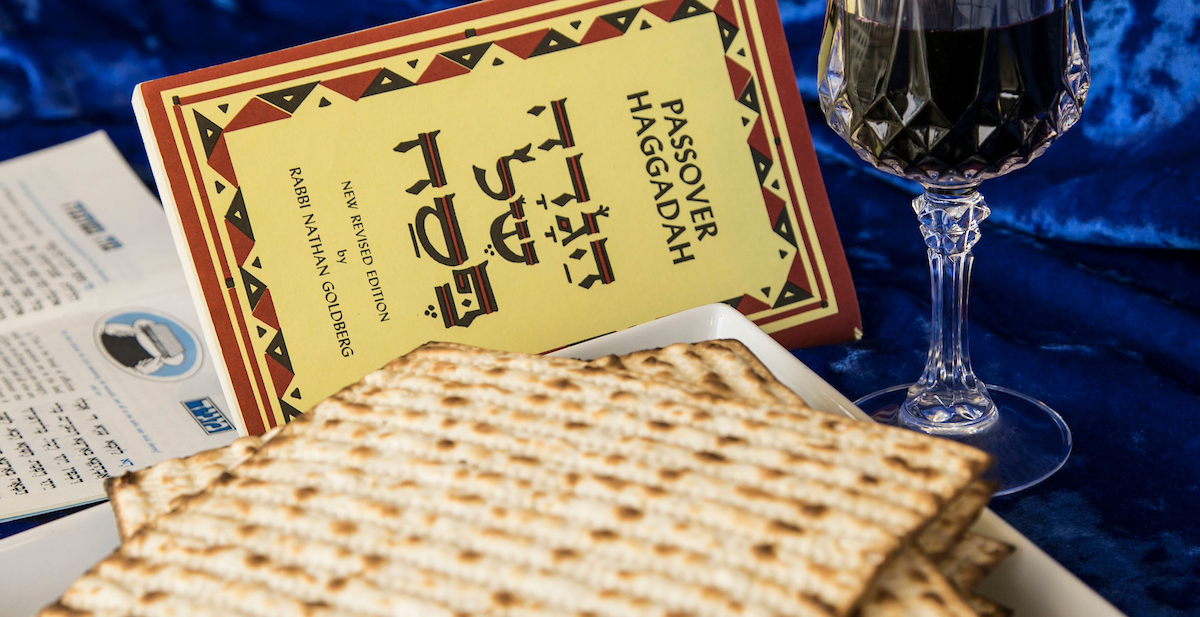 The Haggadah, or telling of the story of how the ancient Hebrews fled Egypt, guides participants during a Passover Seder. Matzah, or unleavened bread, is an integral part of the traditional storytelling. (DePaul University/Jamie Moncrief)