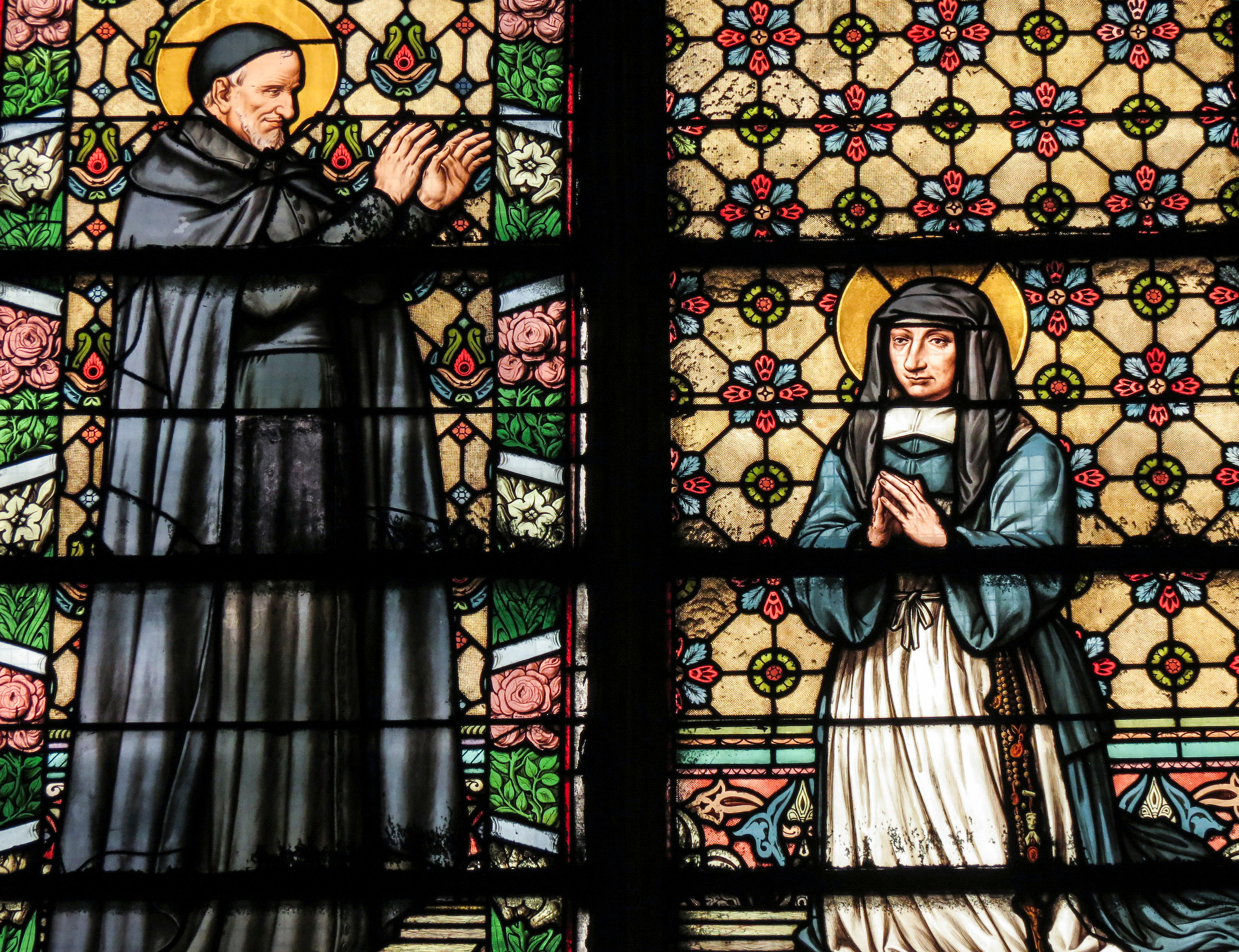 Saint Vincent de Paul blessing the first Sisters of Charity, including Saint Louise de Marillac, shown in a stained-glass window by Pierre Fritel inside the Church of Saint-Laurent in Paris.Faculty and staff who participate in the Vincentian Mission Institute visit the site, which is home to many artifacts highlighting the life of Saint Vincent de Paul. (DePaul University/Jamie Moncrief)