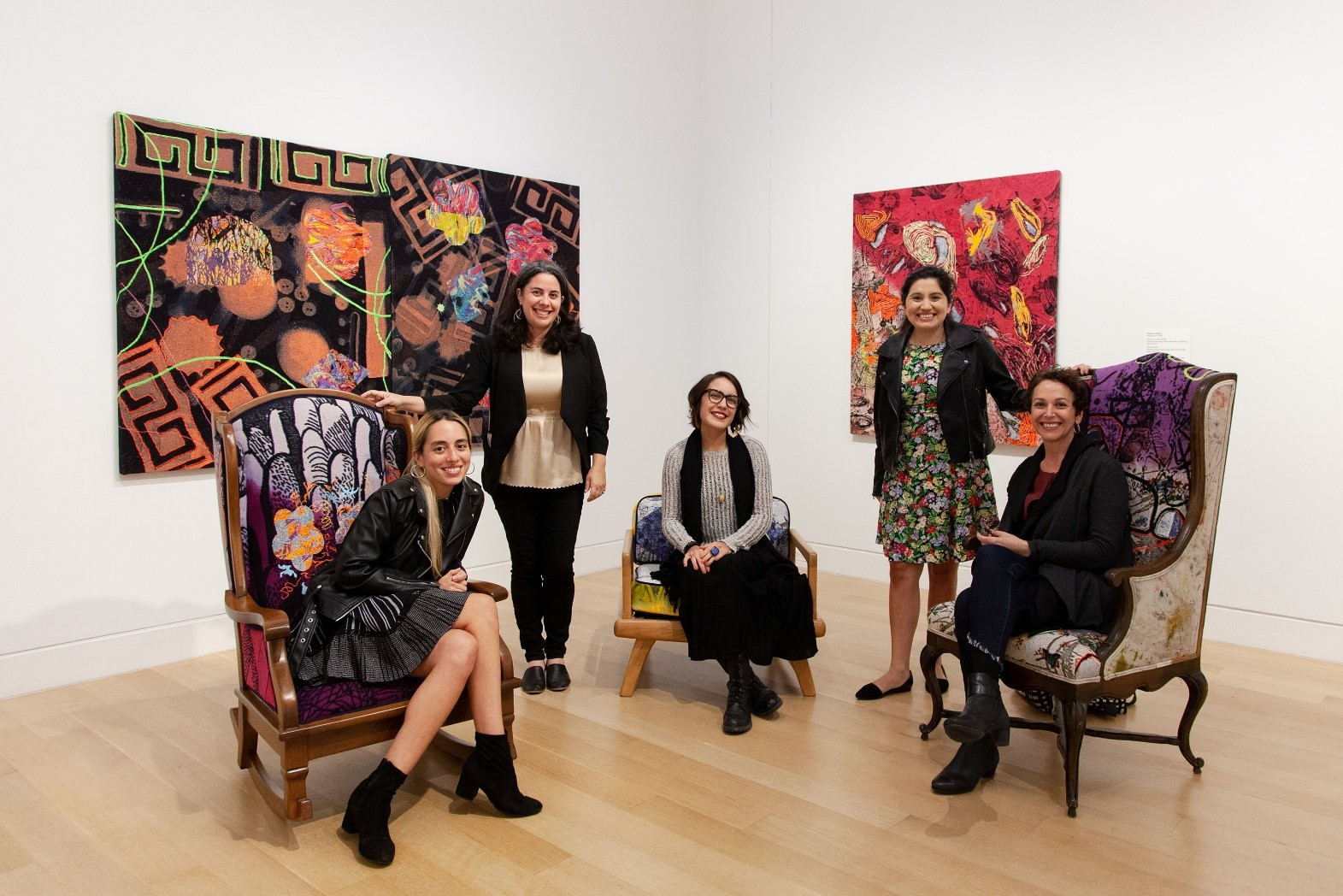 "Artist Melissa Leandro; DePaul Art Museum director and chief curator Julie Rodrigues Widholm; artist Jenelle Esparza; assistant curator Mia Lopez; and artist Dianna Frid gathered at the ""Remember Where You Are"" exhibition at DePaul Art Museum, 2019 (DePaul Art Museum/Madeline Rosemurgy)"
