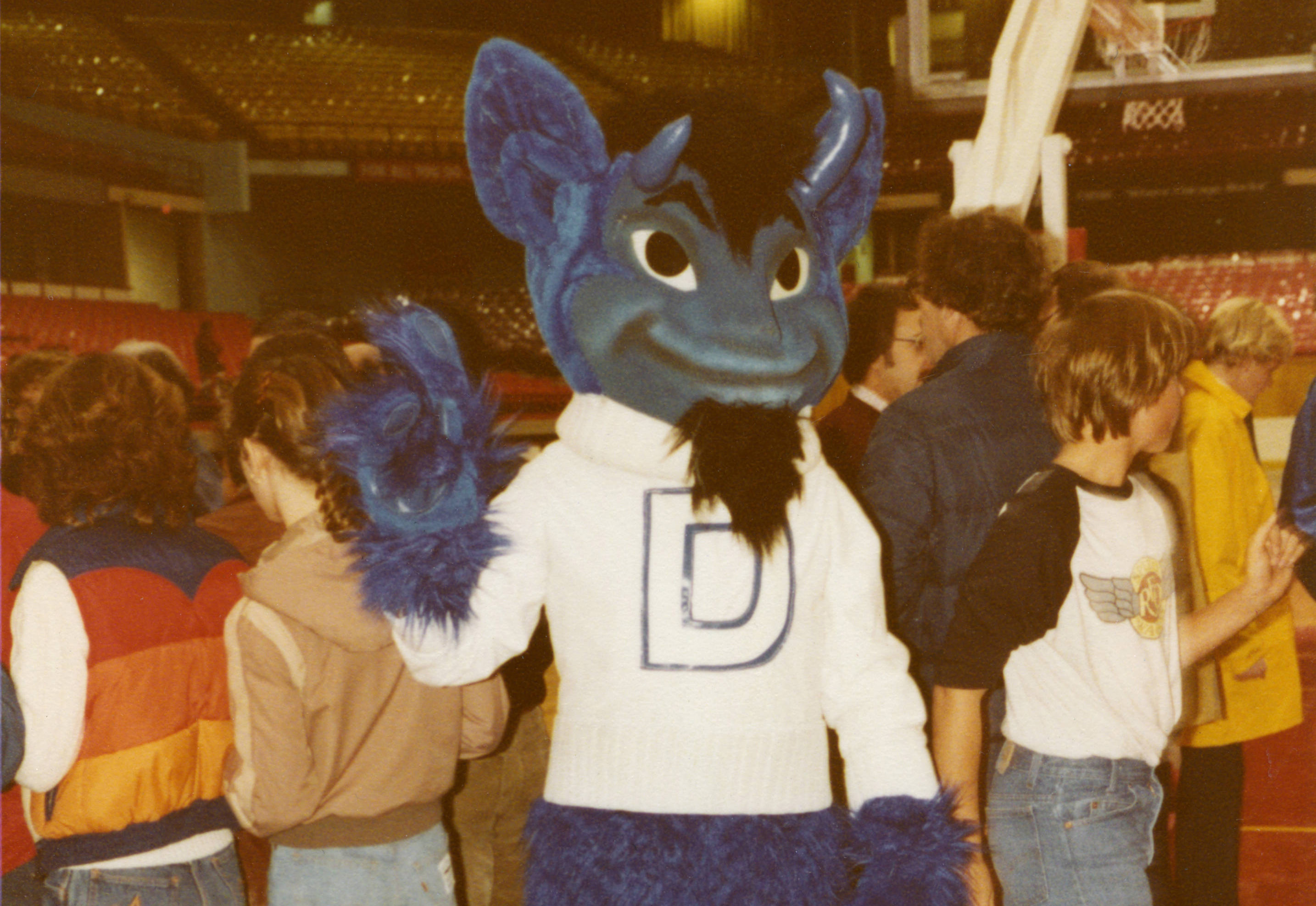 DePaul_mascot_with_students_on_a_basketb
