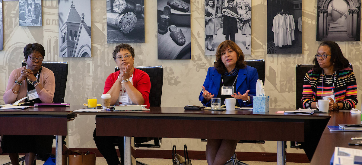 Elizabeth Ortiz, third from left, vice president of DePaul University's Office of Institutional Diversity and Equity