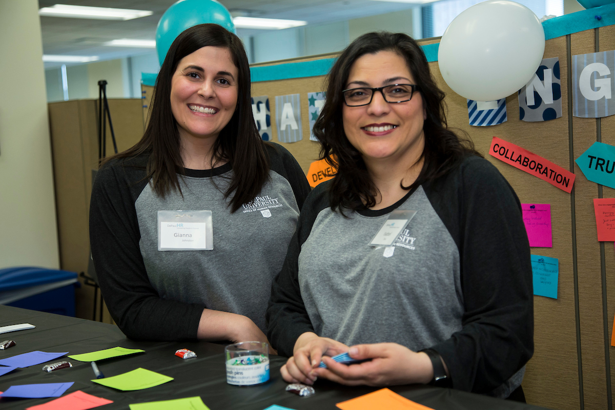 Gianna Johnston, left, a specialist for the Employee Engagement & Equal Employment Opportunity office, and Isabel Diaz, the director of the office, during a Human Resources open house in 2016. (DePaul University/Deanna Williams)