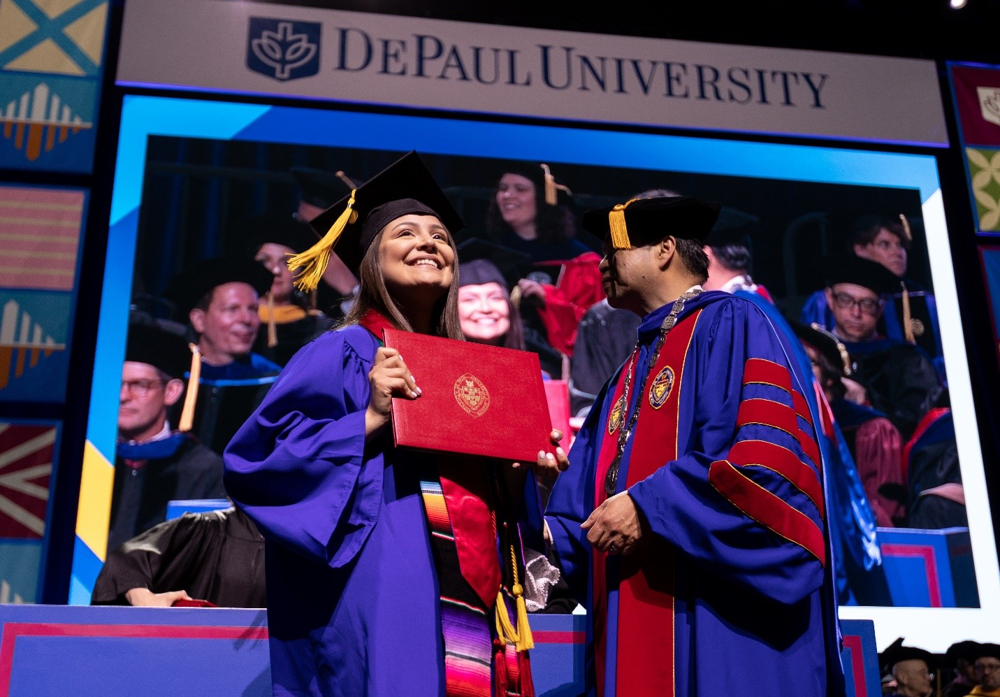 A graduate crosses the stage during the College of Science and Health and School of Music 2019 commencement ceremony. (DePaul University/Jeff Carrion)