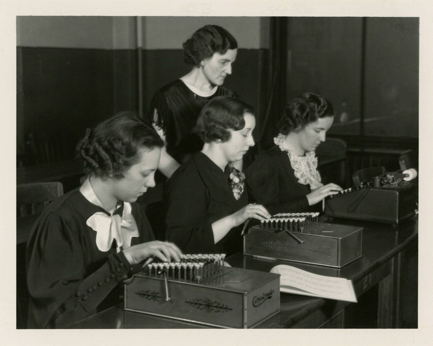 Students practice typing in the 1940s.