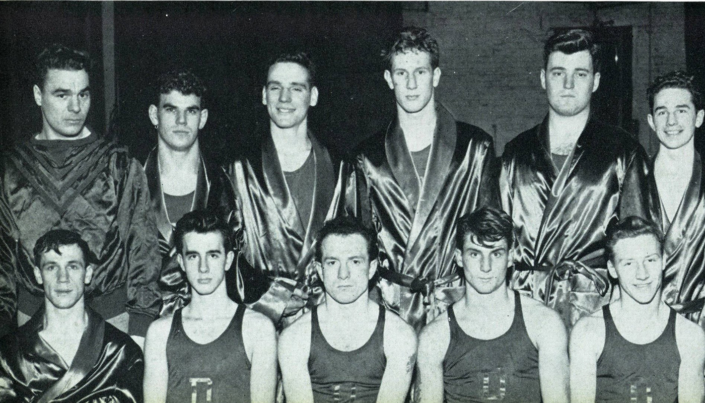 The 1948-49 DePaul University boxing team with coach Paul Mall (top row, first from left) and Engstrom (top row, second from left). (Image courtesy of Special Collections and Archives)
