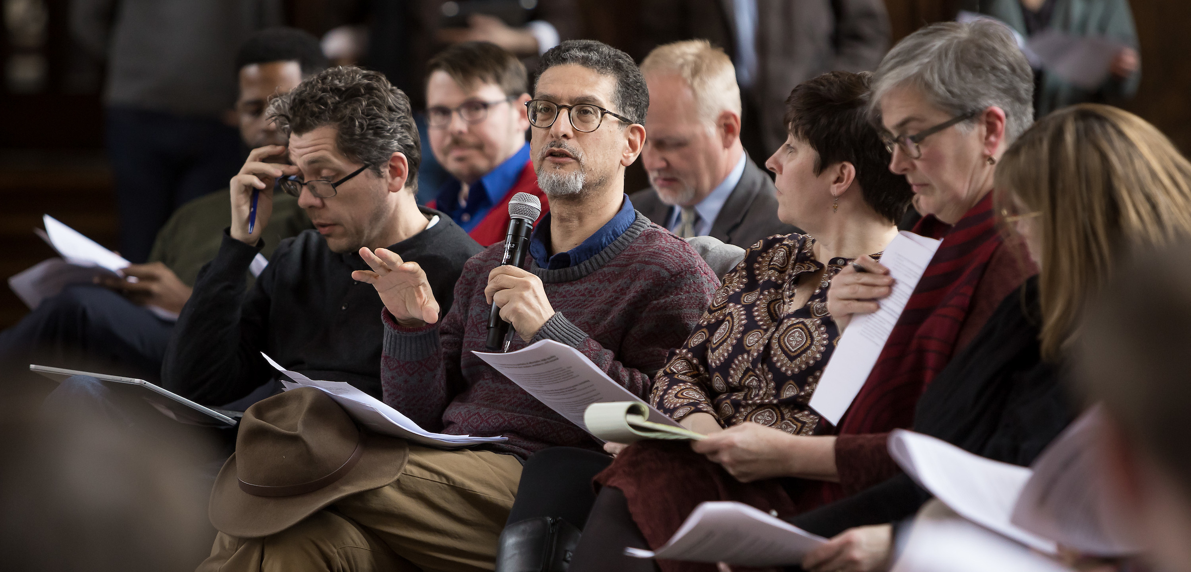 Khaled Keshk, associate professor and chair of Religious Studies, comments during a town hall
