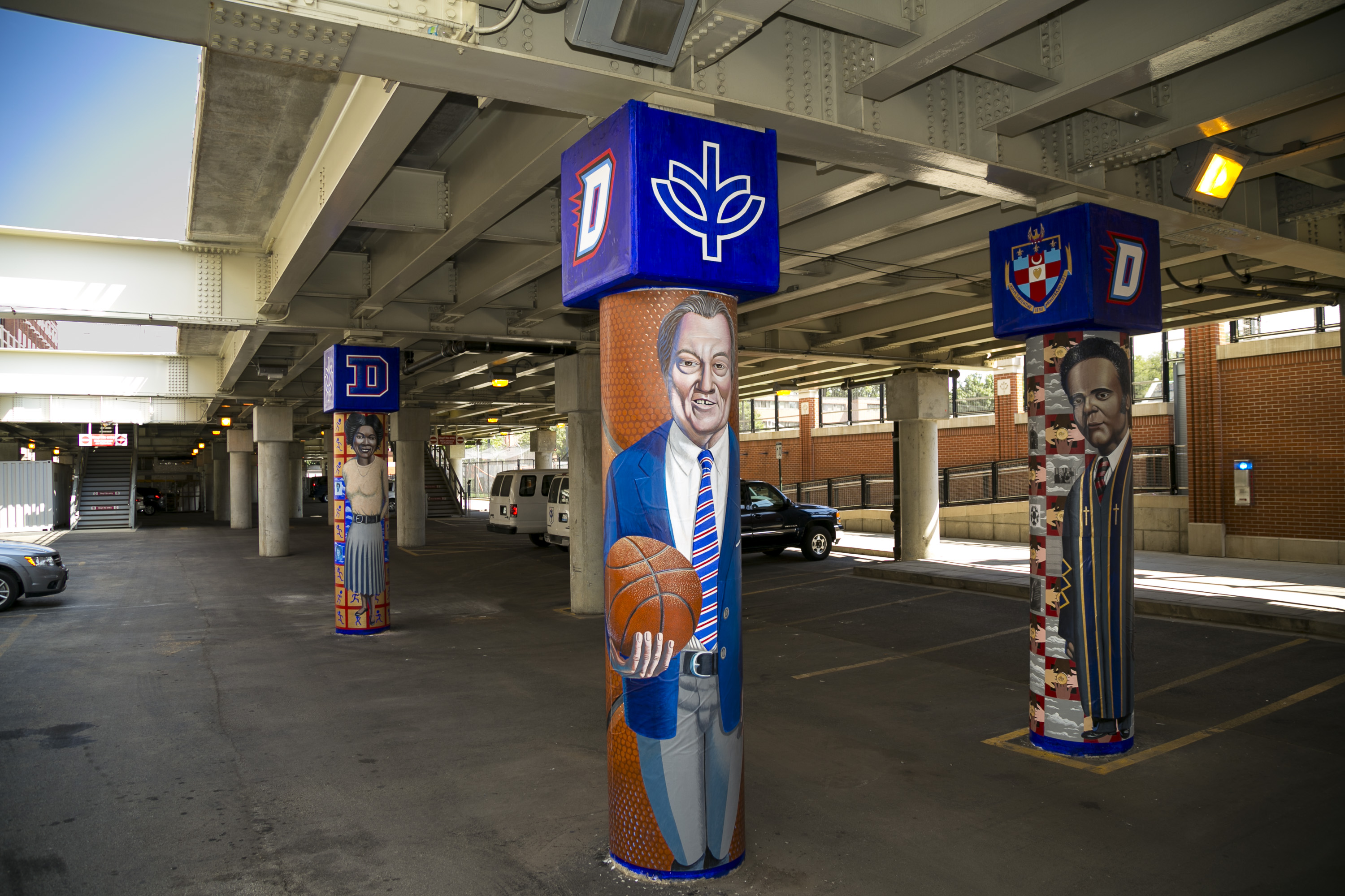 Historical figures from DePaul University past have been memorialized on actual pillars —in a murals painted on the columns beneath the Chicago Fullerton 'L' platform.  (DePaul University/Joel Dik)