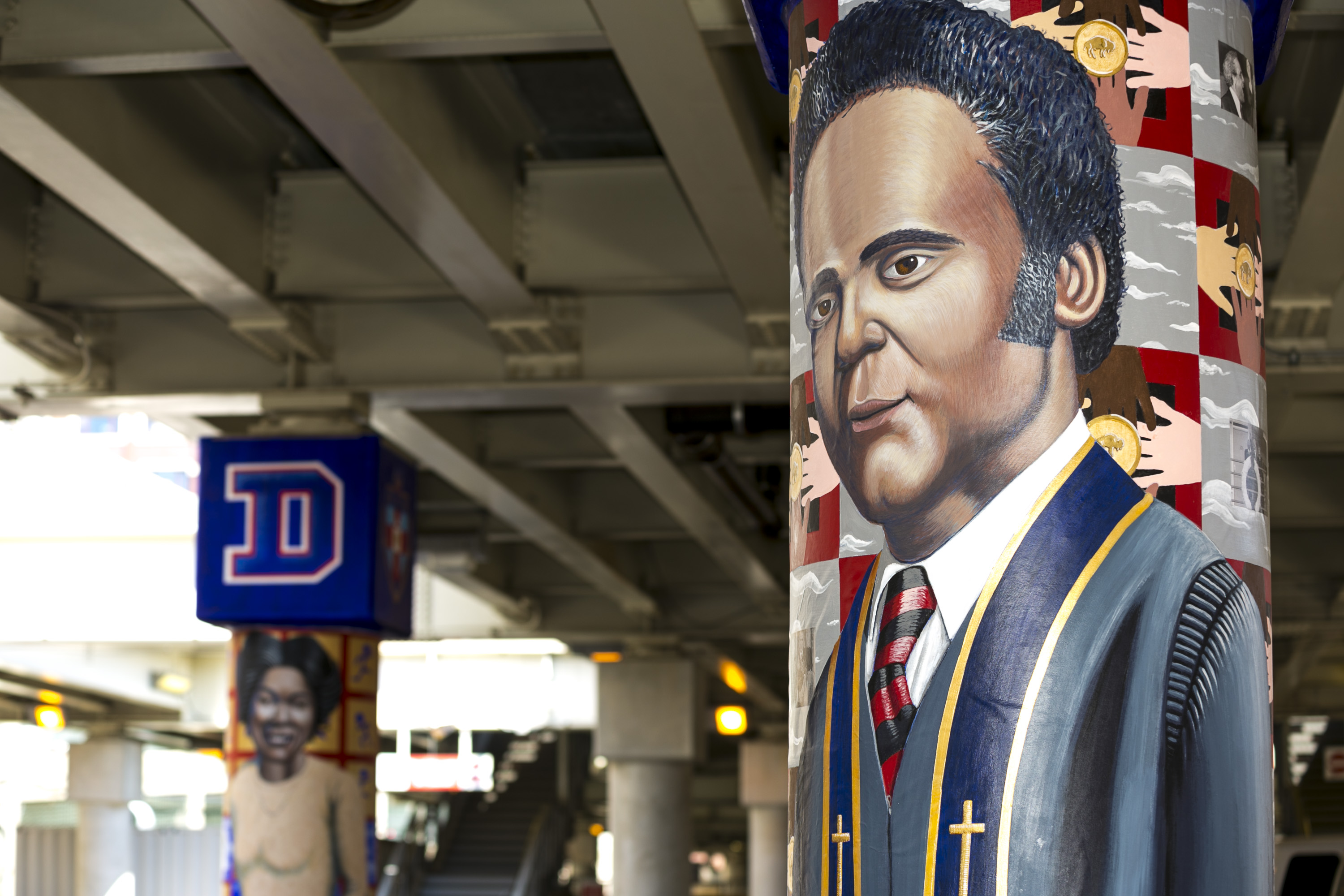 "The mural of civil rights activist and DePaul Law School graduate Benjamin Hooks (foreground) is painted next to Olympian and DePaul track star •	Mabel ""Dolly"" Landry Staton. The murals are part of a larger public art project honoring important historical figures from DePaul's past. (DePaul University/Joel Dik)"