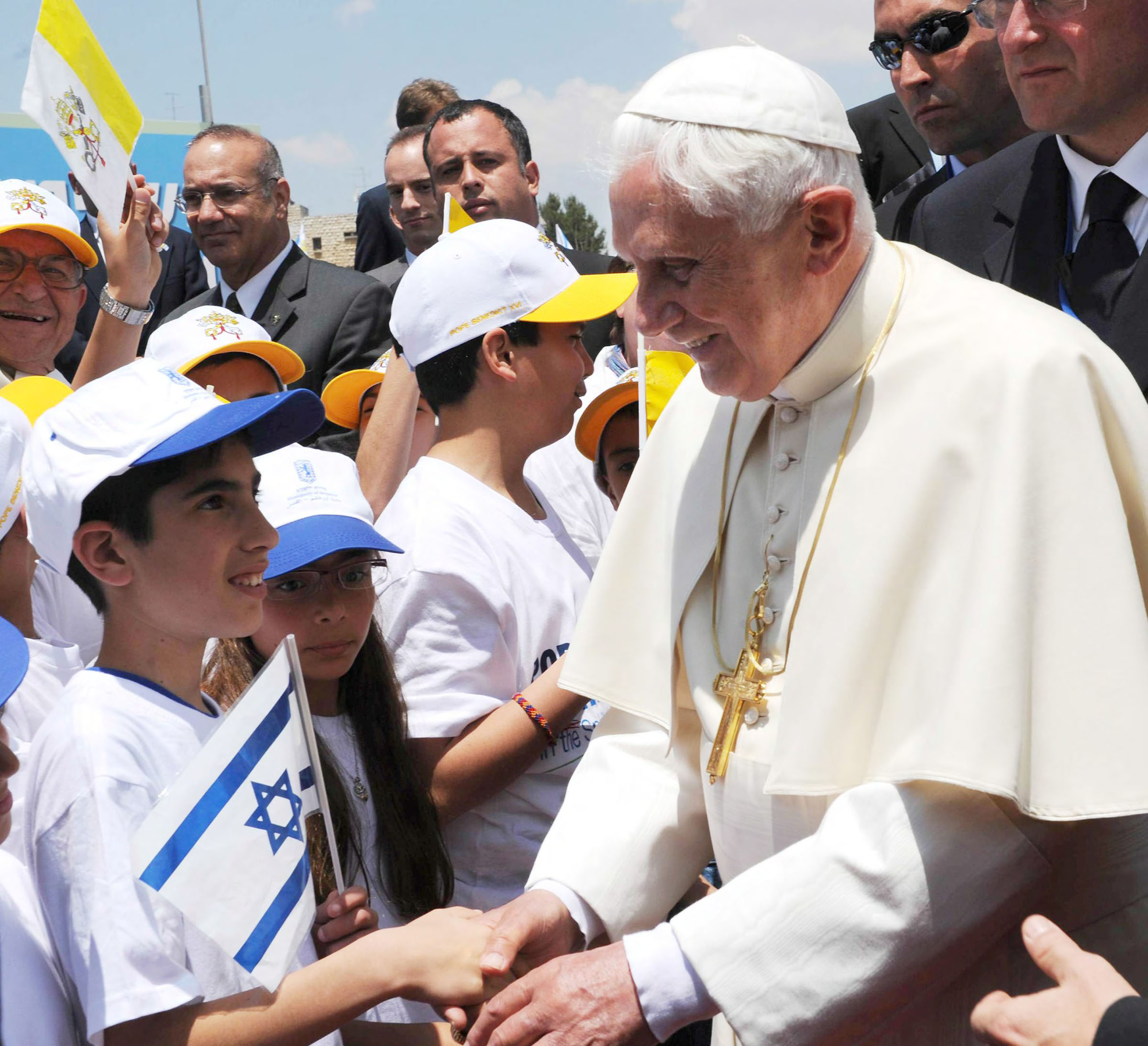 Pope Emeritus Benedict XVI greets children during a visit to Israel in 2009