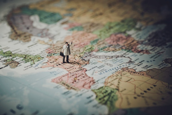 Figurine standing on map of Europe