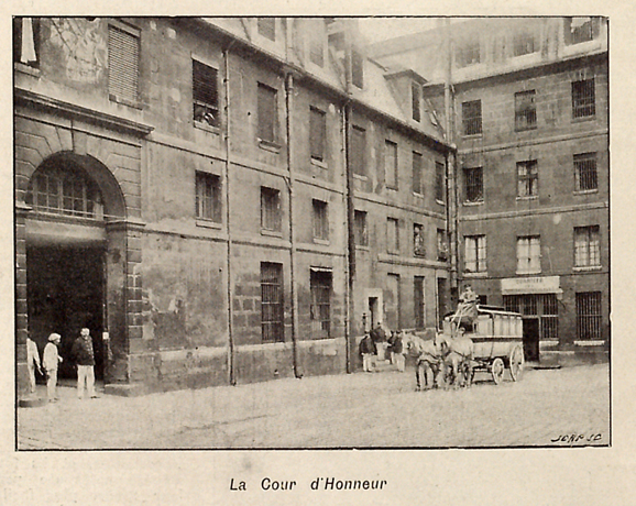 "Exterior view, facing west, cour d'honneur, sundial, ""voiture cellulaire"" for prisoners."